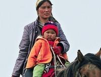 Kazachstan vrouw en kind Djoser